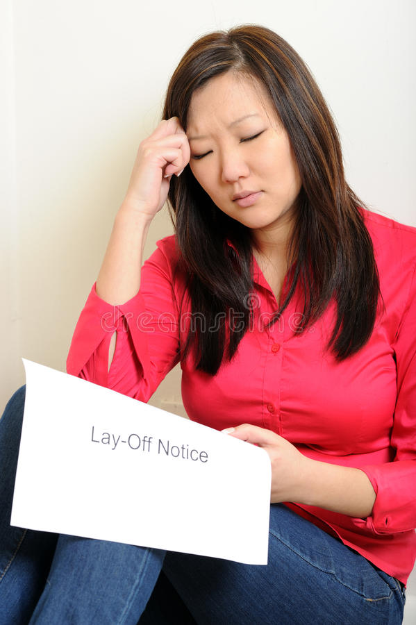 Asian Woman Sad Over Lay-Of Notice Stock Images