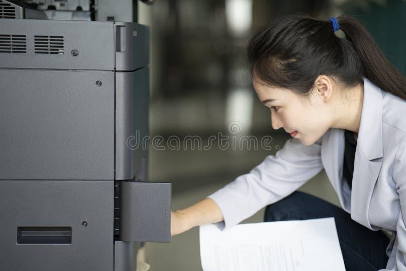 Asian woman secretary using photocopy machine stock photography