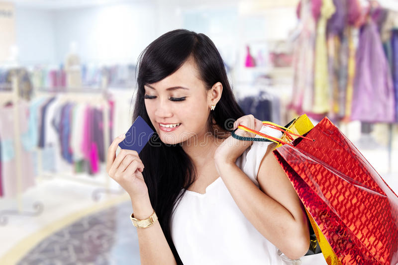 Download Asian Woman With Shopping Bag And A Credit Card Stock Photo - Image: 24690426