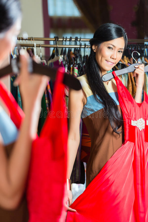 Asian woman shopping in fashion store royalty free stock image