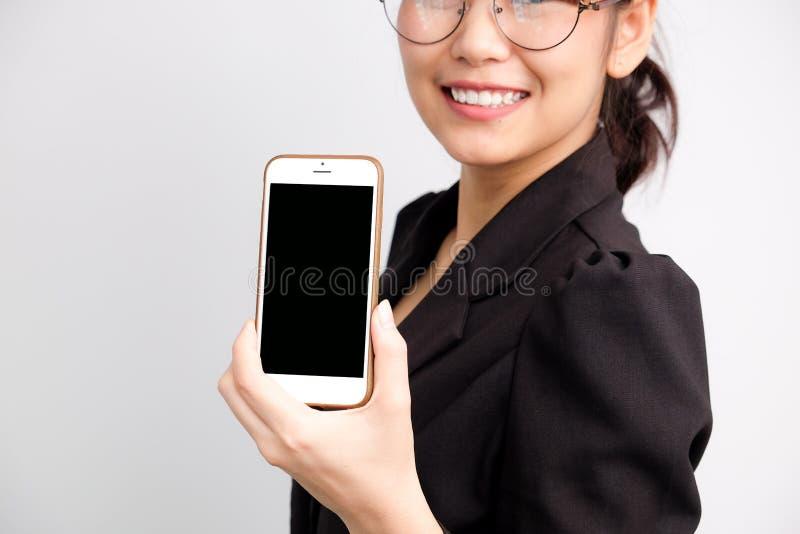 Asian women show blank screen of cellphone royalty free stock photos