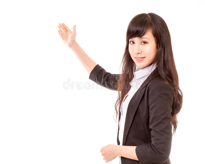 Asian woman showing copyspace or item with her han royalty free stock images