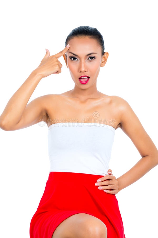 Asian woman showing idiot sign stock image