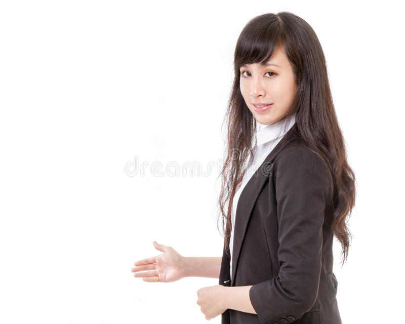Asian woman showing product or copyspace with her hand royalty free stock photo
