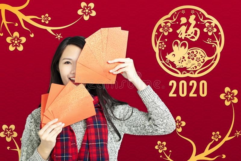 Asian woman showing red envelopes for chinese new year.chinese text happy new year 2020.  royalty free stock image