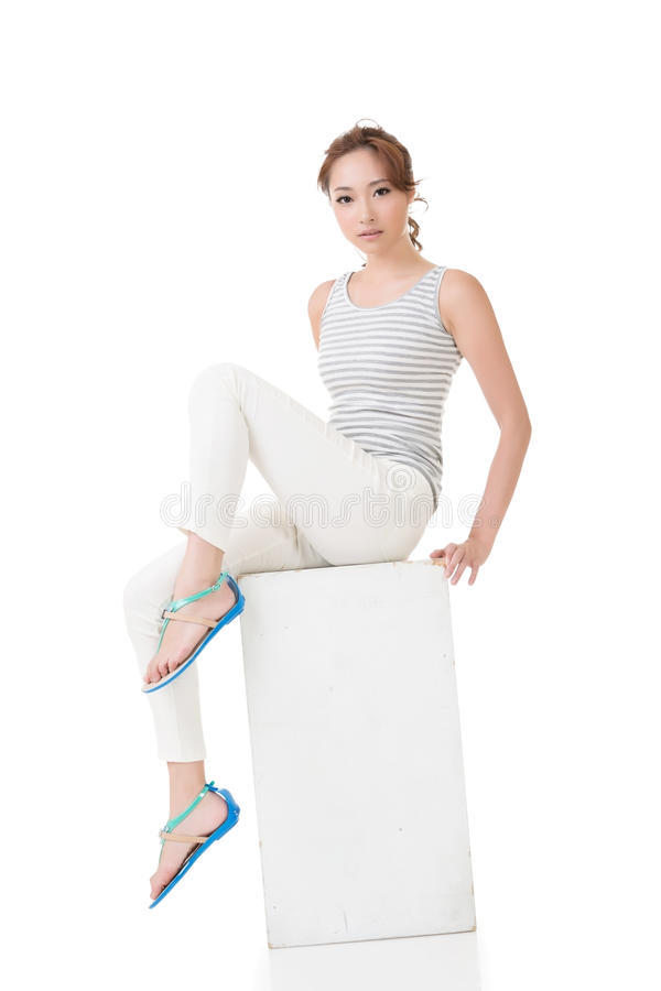 Asian woman sit and pose. Full length portrait royalty free stock photography