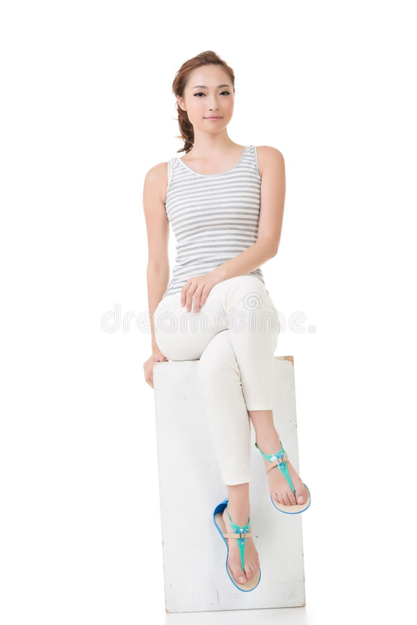 Asian woman sit and pose. Full length portrait stock photo