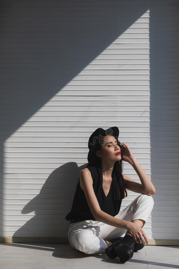 Asian woman sitting near window stock image