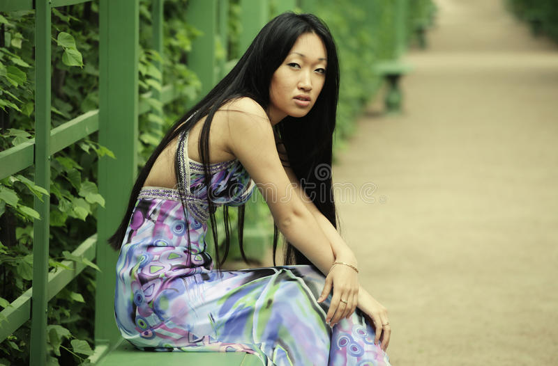 Download Asian Woman Sitting On The Park Bench Stock Photo - Image: 31970898