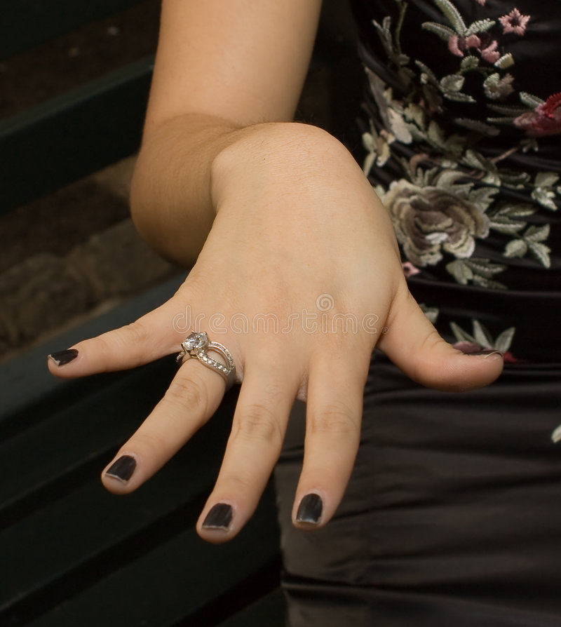 Download Asian Woman Sitting On Park Bench Holding Out Hand Stock Image - Image: 6536299