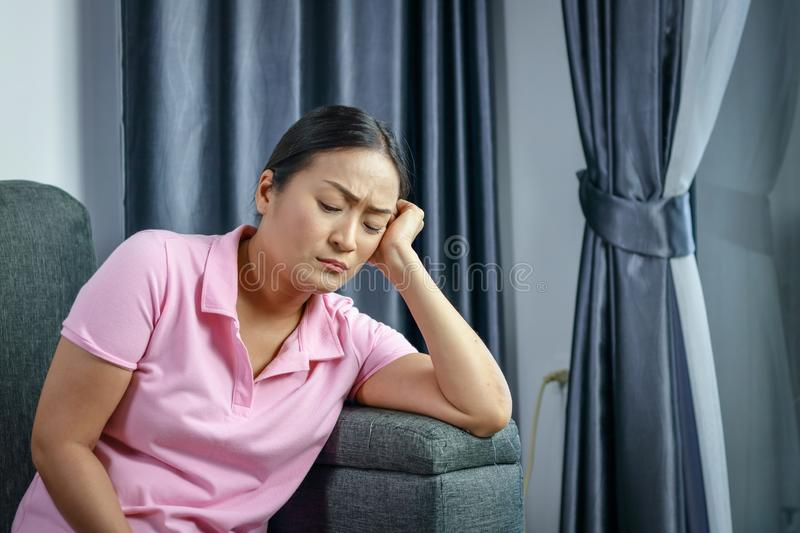 Asian women sitting stressed royalty free stock photography