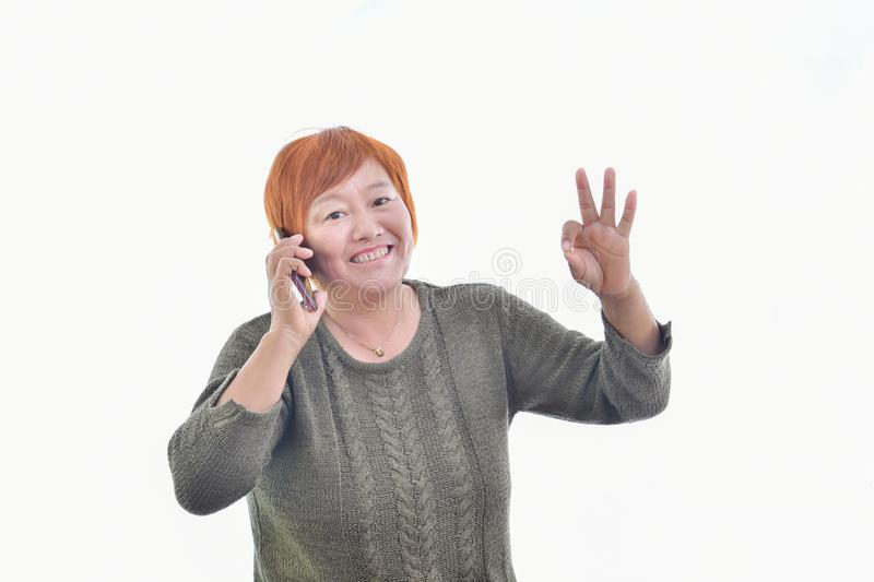 Asian woman with a smart phone royalty free stock photography