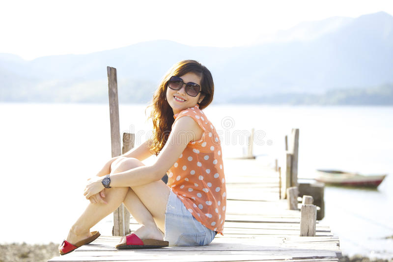 Asian woman smile at sunlight stock photos