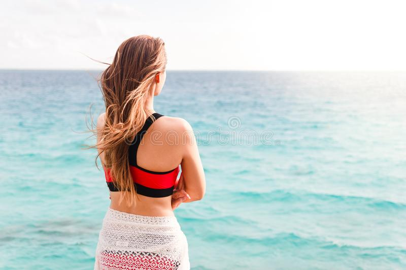 Asian woman standing and looking at sea. stock images