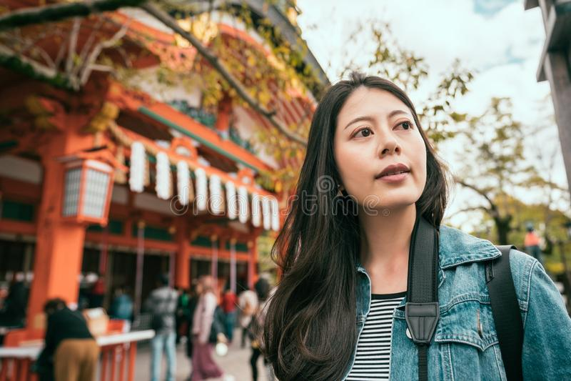Asian woman standing near famous temple. Asian woman with a beautiful smile standing near famous japanese temple in kyoto japan. young girl under sunlight visit royalty free stock photos