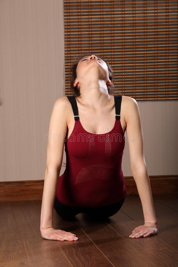 Asian Woman In Stomach Muscle Stretch Exericse Royalty Free Stock Images