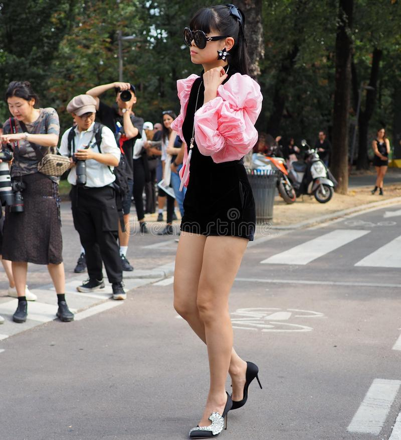 MILAN, Italy: September 22, 2018:Asian woman street style outfit. Asian woman street style outfit in Allemagna street before Philosophy di Lorenzo Serafini royalty free stock image