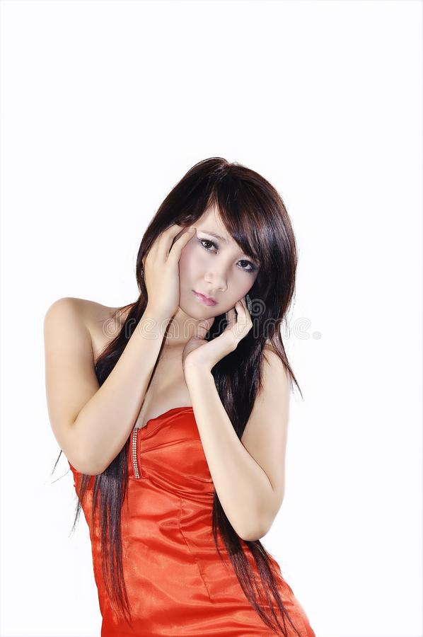 Asian woman in studio glamor shot stock photography