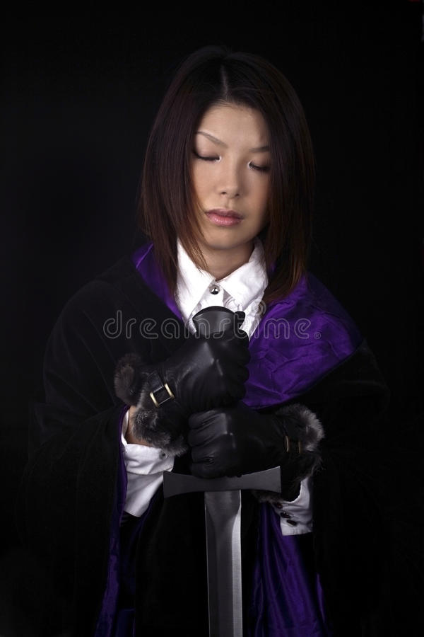 Download Asian woman with sword stock image. Image of female, studio - 13577633