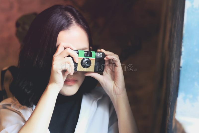 Asian women take a picture by film camera in coffee cafe stock images