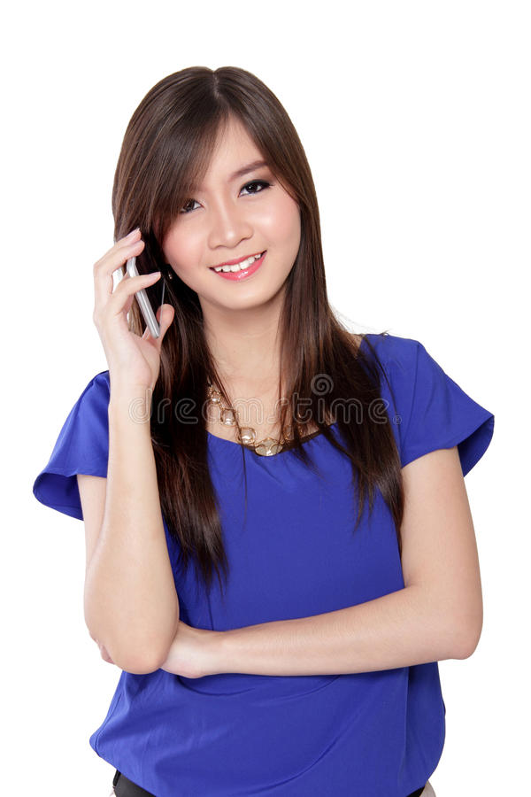 Asian woman talking on cell phone royalty free stock images