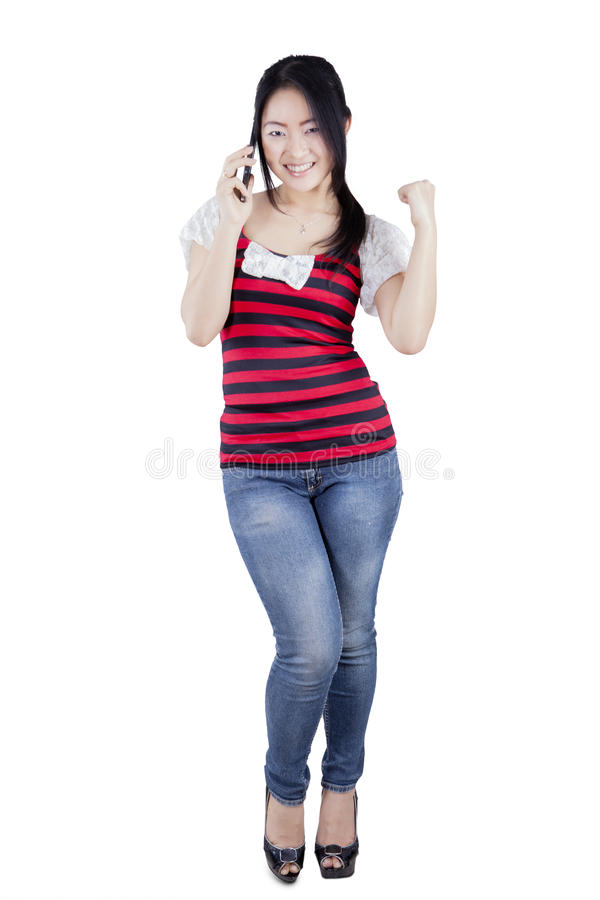 Asian woman talking by smartphone on the studio stock photo