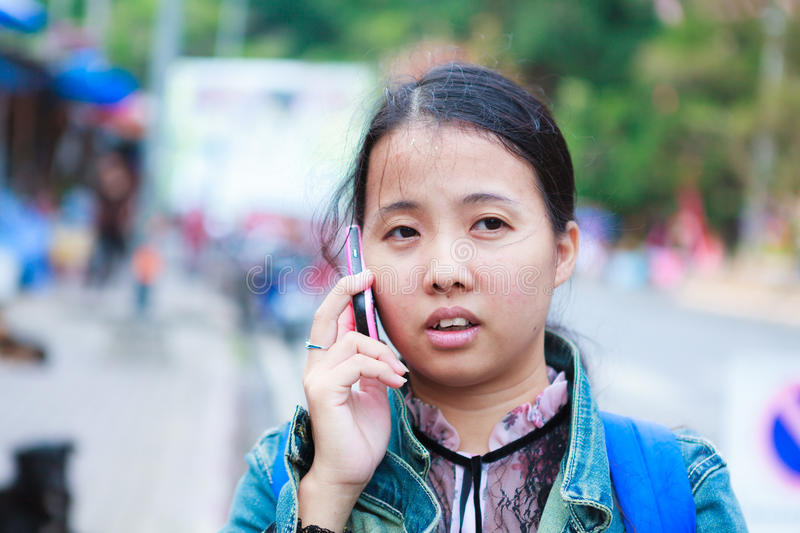 Asian woman talking to phone royalty free stock photography