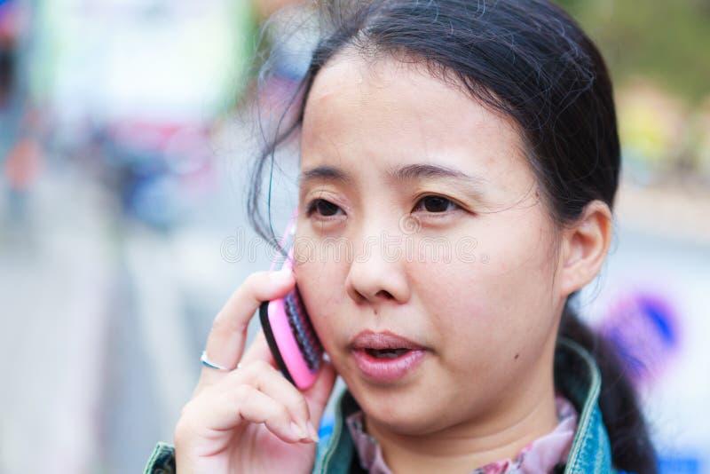 Asian woman talking to phone stock photo