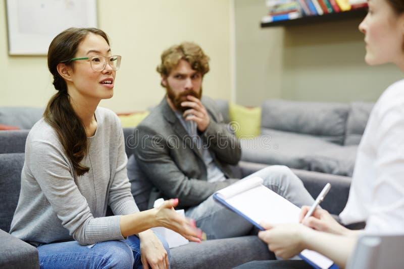 Asian Woman Talking to Psychiatrist royalty free stock image