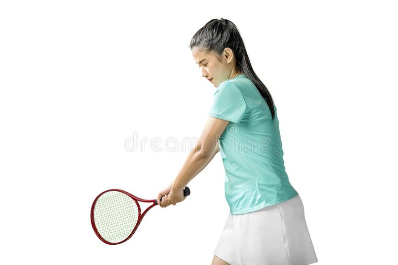 Asian woman with a tennis racket in her hands royalty free stock photography