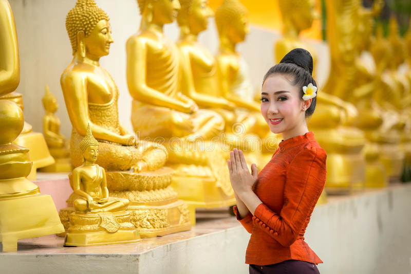 Asian woman to pay respect to Buddha statue in thailand. stock images