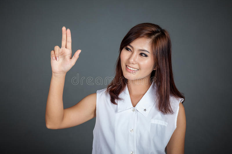 Download Asian Woman Touching The Screen With Two Fingers Stock Photo - Image: 43615512