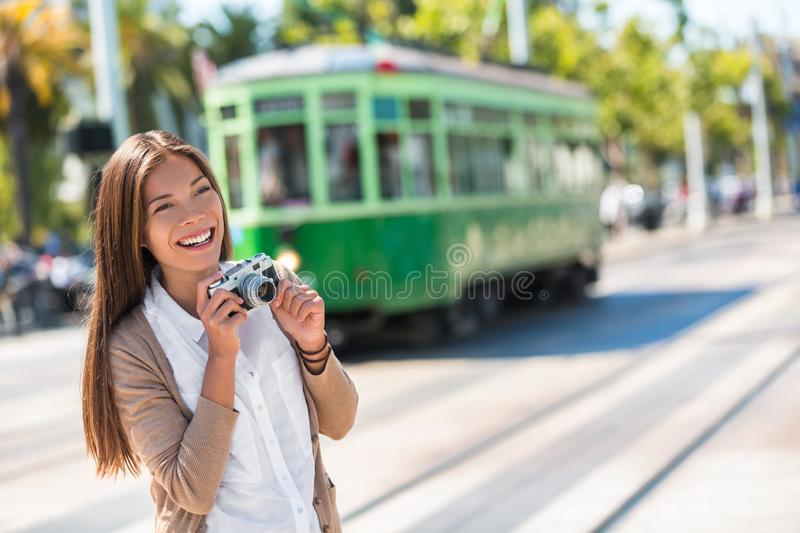 Asian woman tourist -city street lifestyle, famous tramway cable car system in San Francisco city, California during summer. Vacation. Travel fun taking royalty free stock image