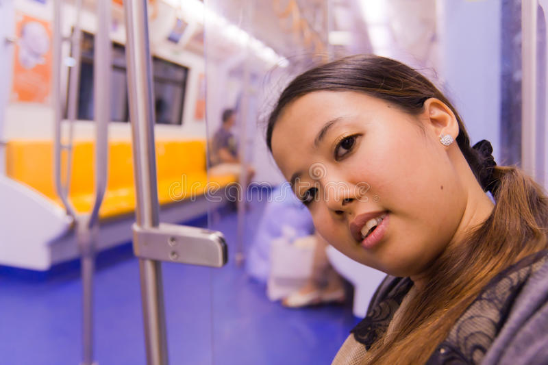 Asian woman on train royalty free stock images