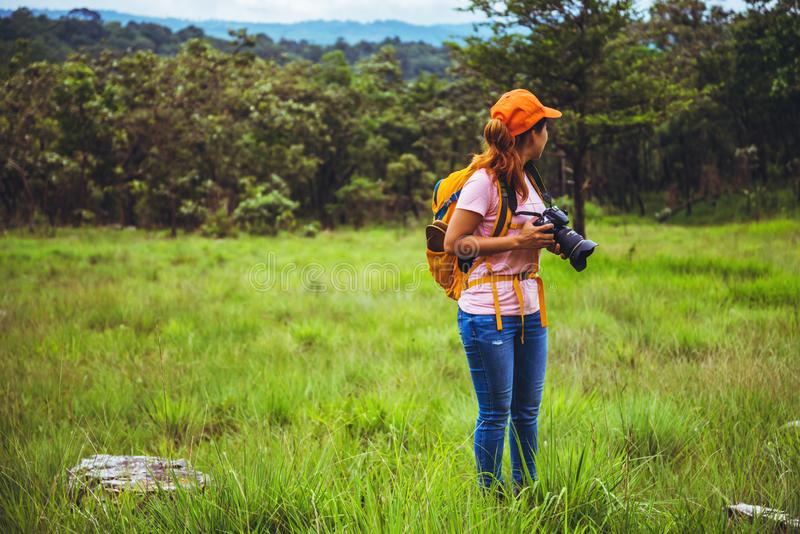 Asian woman travel nature. Travel relax. Photography Cucumber sessilis flower field. Girl travel nature in the holiday. camping summer royalty free stock photo