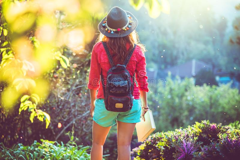 Asian woman travel nature. Travel relax. Study read a book. Nature Education. At public park in summer stock photography