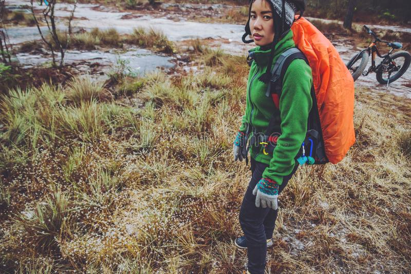 Asian woman travel  Nature. Travel relax. Touch natural mountain meadow. walk in the forest. Thailand. Asian woman travel Nature. Travel relax. Touch natural stock photos