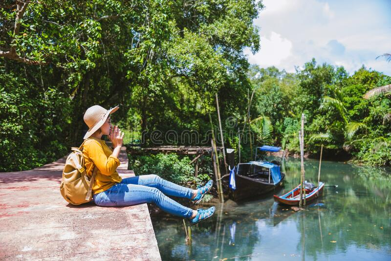 Asian woman travel nature. Travel relax.a boat photo. Sitting watching the beautiful nature at tha pom-klong-song-nam. Krabi, in. Thailand royalty free stock photos