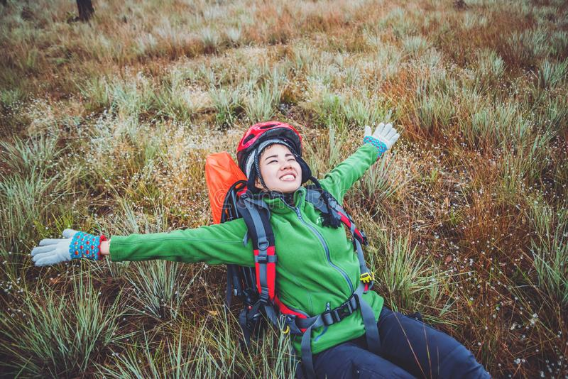 Asian woman travel  Nature. Travel relax. Touch natural mountain meadow. walk in the forest. Thailand. Asian woman travel Nature. Travel relax. Touch natural stock photo