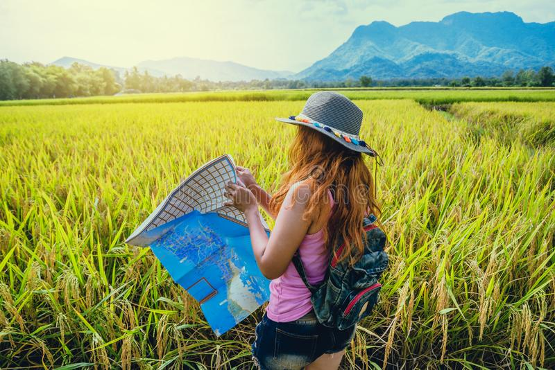 Asian women travel relax in the holiday. Expand survey map Mountain field. Thailand. Asian woman travel relax in the holiday. Expand survey map Mountain field stock images