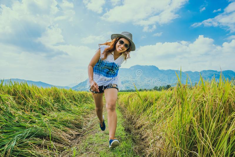 Asian women travel relax in the holiday. Stand natural touch mountain field. Thailand. Asian woman travel relax in the holiday. Stand natural touch mountain royalty free stock images