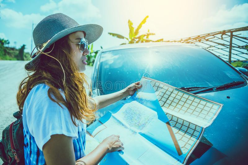 Asian woman travel relax in the holiday. watch the map. Explore the car route in tourism stock photos