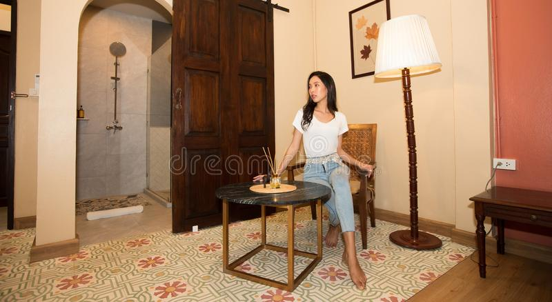 Asian Women Travelers enjoy travel and check in stock photos