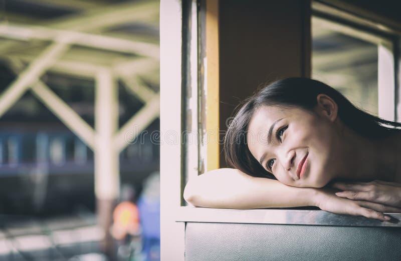 Asian woman traveler has exciting with traveling by train at Hua Lamphong station at Bangkok, Thailand. stock photos