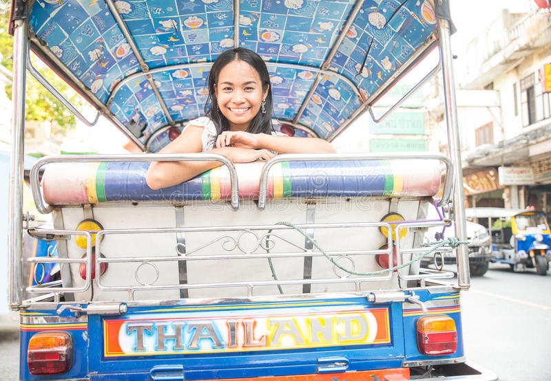 Asian woman on tuk tuk royalty free stock photos