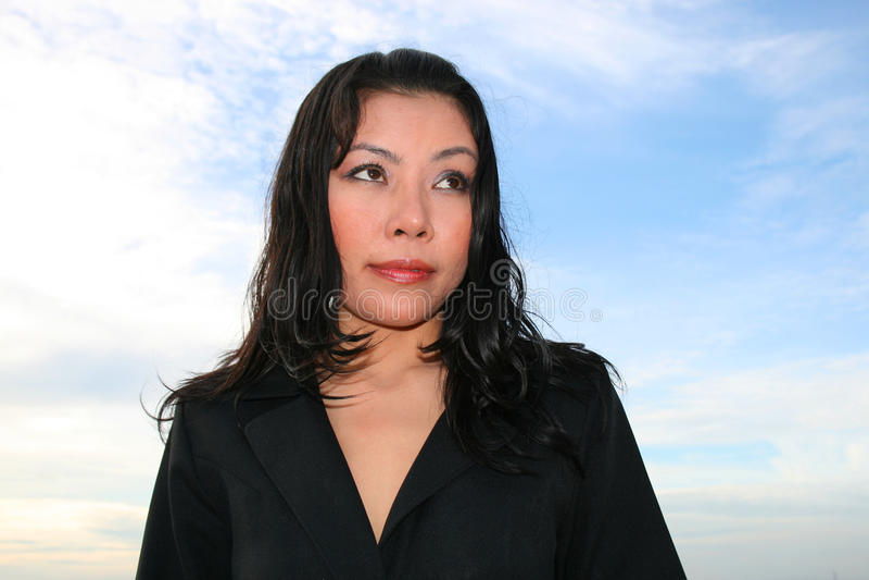 Asian woman under a cloudy sky. royalty free stock photos