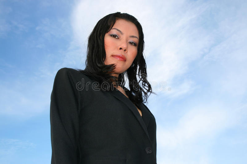Asian woman under a cloudy sky. stock image