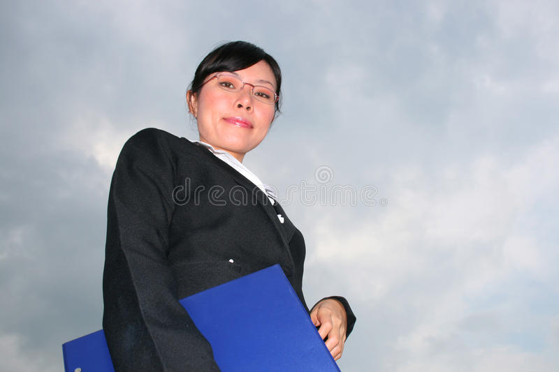 Asian woman under a cloudy sky. stock photo