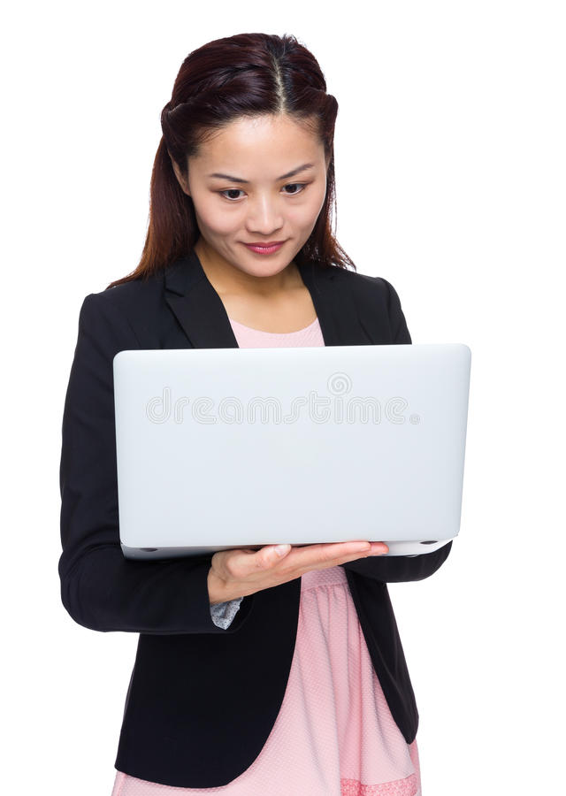 Asian woman use of the notebook computer stock photos