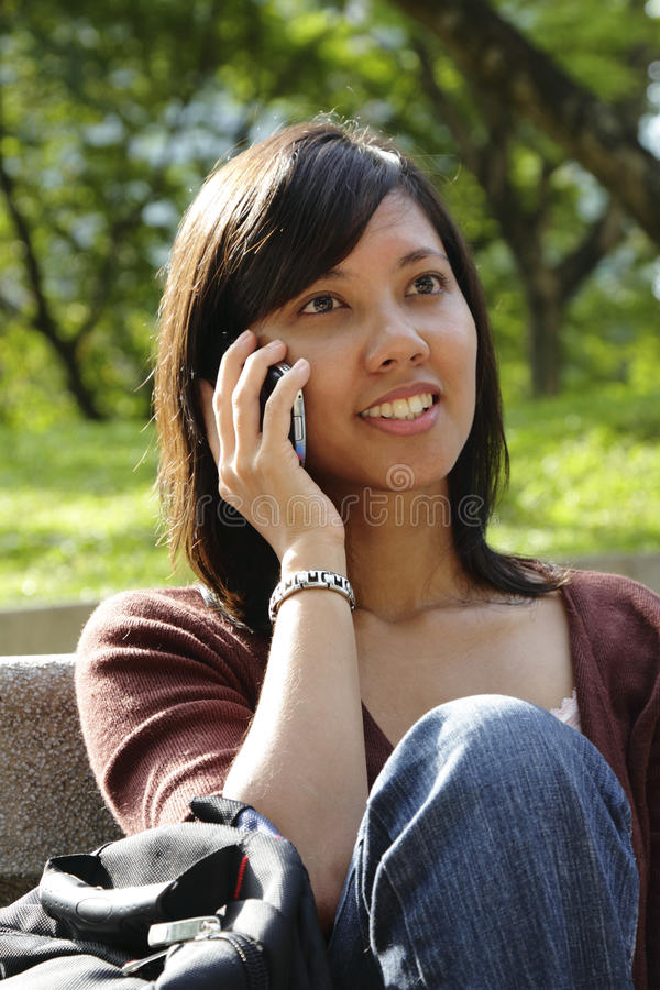 Asian Woman Using Cellphone Stock Images